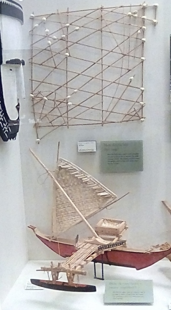 The top is a map of the water around the area, the bottom is a model boat.